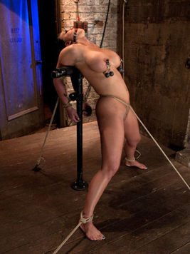 Mackenzee Pierce shows off her hard dark nipples which get pinched while she is tied up.