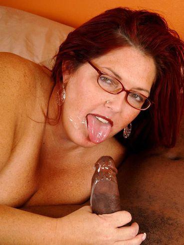Mature plump redhead Peaches Larue in glasses sucks the cum out of black cock