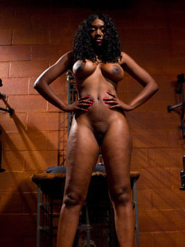 Busty black mistress Nyomi Banxxx fucks slave guy in the ass and then strips naked