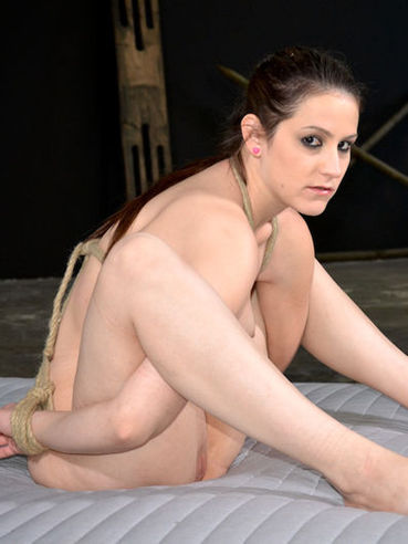 Hard tied dark-haired slave chick Addie Juniper loves playing with sex toys