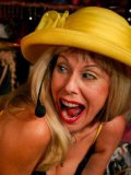 Kinky milf Susan Block in yellow hat bends over and gets her ass spanked