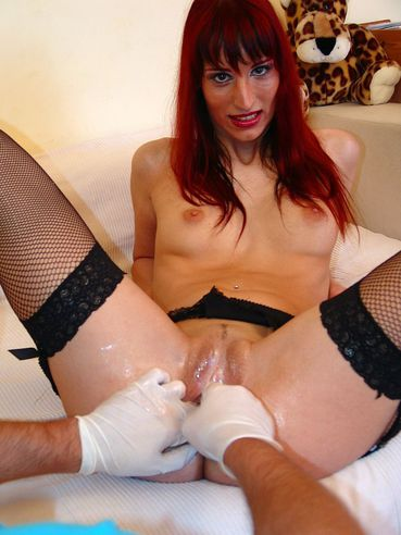 Long legged redhead Gina Bitch in black stockings enjoys fisting with the help of Jane F