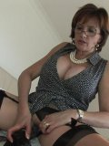 Seasoned fetish lover Lady Sonia sucking on a massive dildo and getting her slit wet and sticky.