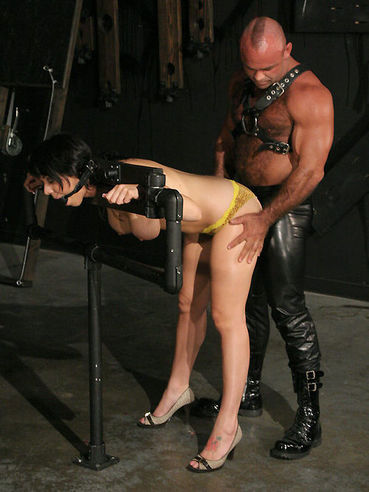 Charming slave Beverly Hills has her hands and legs tied and pussy heavily penetrated
