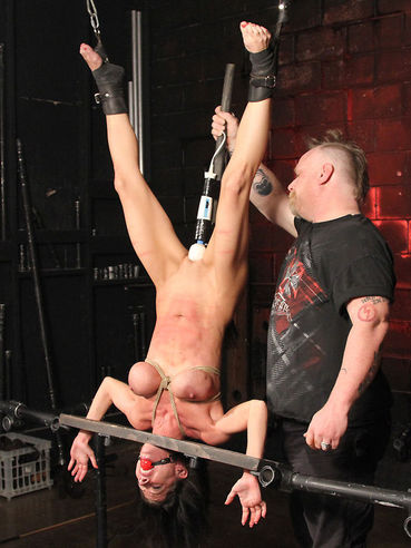 Bondage master uses various toys to play with pussy and asshole of restrained Little Angel