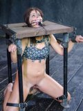 Mia Gold captured and in bizarre metal chains gets spider-gagged and humiliated in bondage.