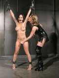 Busty spreadeagle bound Kali Kane gets vibrated by Regan Reese in tight latex dress
