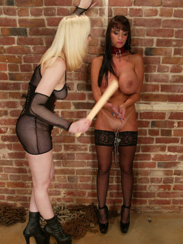 Slave Cowgirl with giant round tits gets painfully spanked by blonde dom Cowgirl