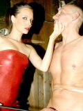 Helpless man gets tortured by mistress Lady Sandy in red mini dress and black shoes