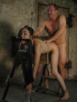 Tall slender slave brunette Sasha Grey with hairy pussy sucks and fucks in the dungeon