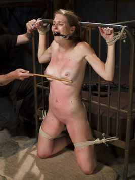 Ashley Lane spreading her pink and perfectly shaved cunt during kinky bondage with sex toys.