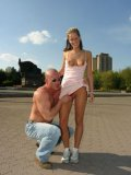 Topless muscle man asks Chantal to flash her small tits and bald pussy on the square