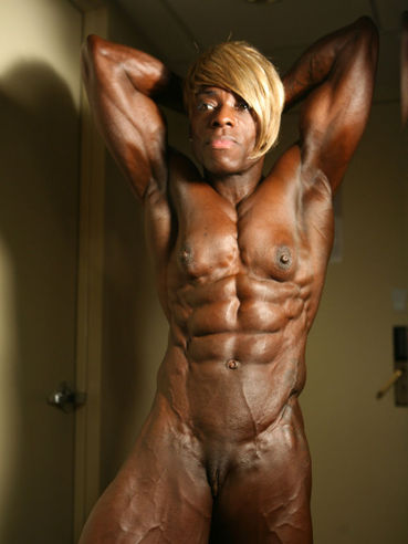 Black hard body female bodybuilder Roxanne Edwards is fully nude in front of you