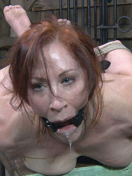 Hogtied redhead slave Catherine De Sade with bald meaty pussy gets face fucked by master