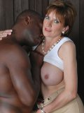 Lady onia in trousers and white top is pleasing the body of the strong black guy