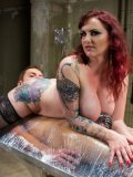 Tattooed bitch Mz Berlin with red curly hair waxes a guy's hard dick and humiliates him.