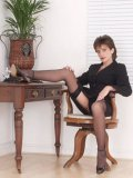 Fetish lover Lady Sonia elegantly dressed and in a mood for some kinky posing and pussy teasing.