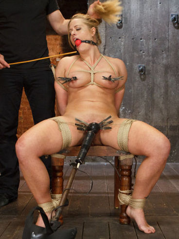 Holly Heart tied to a chair during hot bondage and getting her mouth and slit filled with plastic.