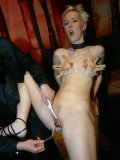 Masters plays with helpless pussy of Malou Rouge after clothespin torture