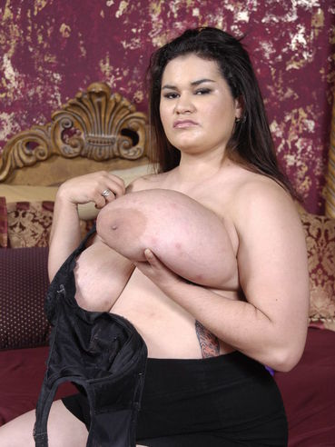 Bulky latina Haydee Rodriguez strips naked and makes dildo disappear in her loose hole