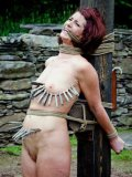 Tight chick Cici Rhodes is bound outdoors and made to endure some serious stuff