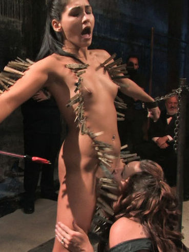 Jade Indica has hundreds of pins on her naked body and gets forced into sucking dick