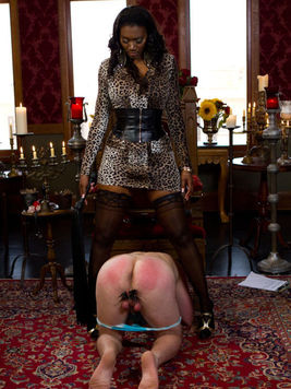 Black slut Nyomi Banxxx dresses her bitch in female clothes and stretches his balls' skin.