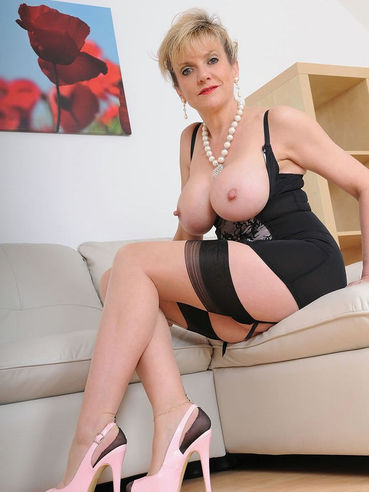 Blonde milf Lady Sonia teases her fans by spreading her legs and showing shaved wet pussy.