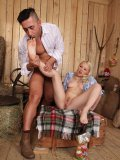 Fetish expert Lola Taylor dressed as a cowgirl and having her small feet licked by a muscular hunk.