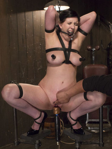 Nerine Mechanique getting her curvy body pegged and stimulated hard in kinky bondage.