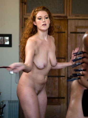 Long haired naked redhead domina Sabrina Fox playing with obedient Lobo