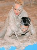 Blonde Sharka Blue shows her love for mud wrestling at the all-girl party