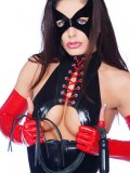 Kinky fetish model Ruby in red and black fishnet outfit shows her private parts