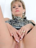 Mature Lady Sonia takes off her see through panties and shows her shaved snatch