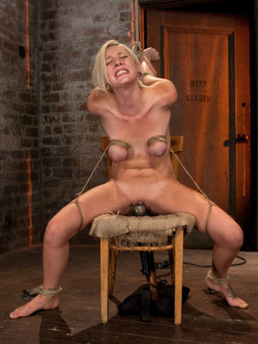 Hot blonde Rylie Richman tit-tied in hardcore bondage while deep-throating a fat and shaved cock.