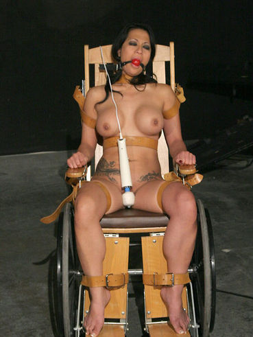 Master Liam ties busty Gianna Lynn to wheel-chair and then toys her helpless slit