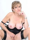 Naughty middle aged fetish model Lady Sonia exposes her big tits and snatch