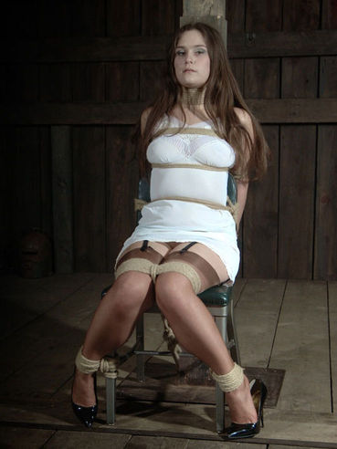 Busty slave girl Charlotte Vale gets tied up with her white see through dress on