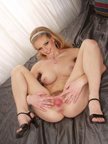Blonde model Tangi has a hairy pussy which is more than ready for this penis.