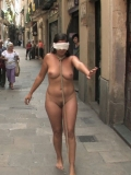 Blindfolded girl Salma de Nora has the rope on her neck as walking along the streets naked.