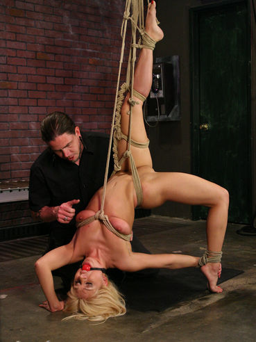 Rope bound slave blonde Lea Lexus with red ball gag in her mouth gets spanked and vibrated