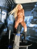 Long haired blonde Fabienne Cesar in platform boots rides a dildo machine