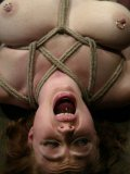 Ball gagged Adrianna Nicole with pink bald pussy gives electro bondage a try