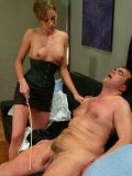 Unmerciful dominatrix Audrey Leigh having fun with her fuckable male slave