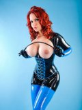 Latex doll Bianca Beauchamp poses in amazing tight black and blue suit showing her huge boobs