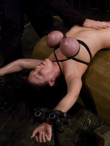 Slave Claire Dames with giant bound tits gets her back arched and her slit toyed.