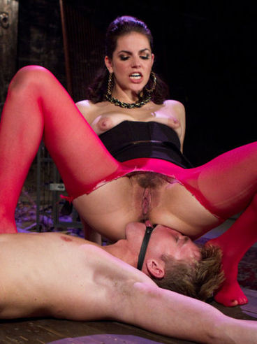 Hot babe Bobbi Starr in red stockings loves using her male servants as sluts and riding their faces