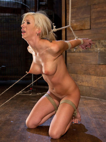 Horny blonde Kaylee Hilton gets hogtied and her boobs with hard nipples get pulled ruthlessly.