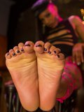 Nikki Darling making her feet sticky while a foot fetish loving hunk licks and stimulates them.