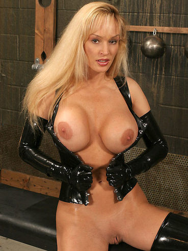 Big racked latex clad milf Tanya Danielle gets tied to bondage table and rubbed with vibrator